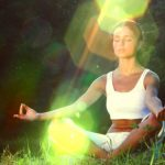 young-woman-meditating-in-nature